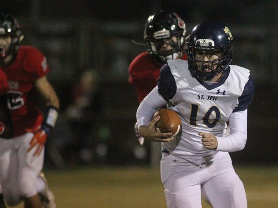 St. John Paul II quarterback Brian Woodend takes off