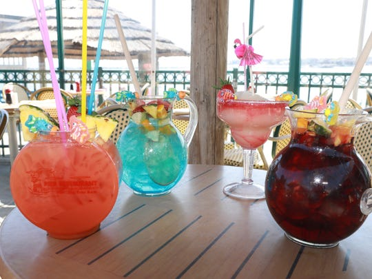 From left, the Fish bowl with pier punch, Tiki Blue Sangria, Strawberry Margarita, and classic Sangria are drinks served at the Tiki Bar in Rye May 1, 2018.