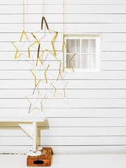 Hang these decorative ornaments from a porch ceiling