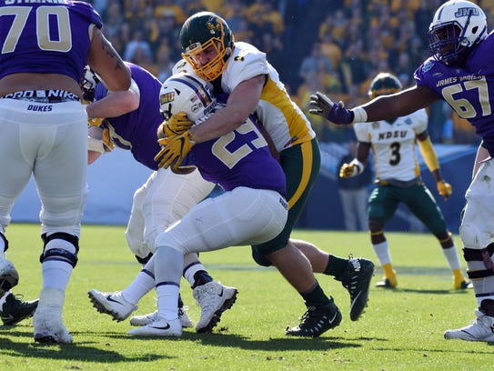 Nate Tanguay tackles a James Madison player in the