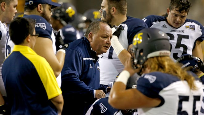 Northern Arizona University head coach Jerome Souers talks to his football team.