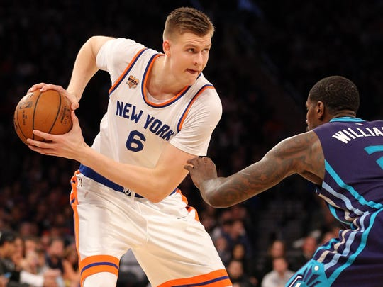 New York Knicks power forward Kristaps Porzingis (6) controls the ball against Charlotte Hornets power forward Marvin Williams (2) during the fourth quarter at Madison Square Garden. Brad Penner-USA TODAY Sports