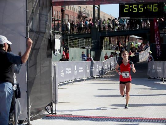 December 2, 2017 - Top female finisher Kayla Brown,