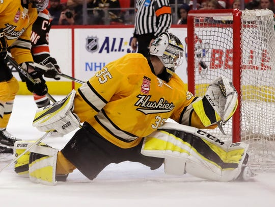 Michigan Tech goaltender Robbie Beydoun (35) watches