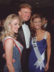 Donald Trump, in Branson for the Miss USA pageant in 1999, puts his arms around Miss Utah USA Rachel Rasmussen and Miss Virginia USA Kellie Lightbourn.