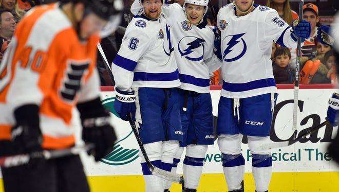 Tampa Bay Lightning's Vladislav Namestnikov, second from right, celebrates his goal with Jake Dotchin, right, and Anton Stralman during the third period of an NHL hockey game against the Philadelphia Flyers, Thursday, Jan. 25, 2018, in Philadelphia. The Lightning won 5-1. (AP Photo/Derik Hamilton)