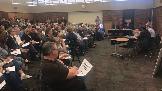 A packed downtown library room forced city officials to find more space for the first of what could be many annexation task force meetings.