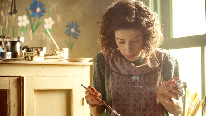 """In """"Maudie,"""" the title character (played by Sally Hawkins) paints everything — the walls, the stove, the doors, the bread box,"""