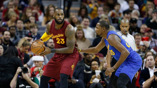 LeBron James is guarded by Kevin Durant at Quicken Loans Arena.
