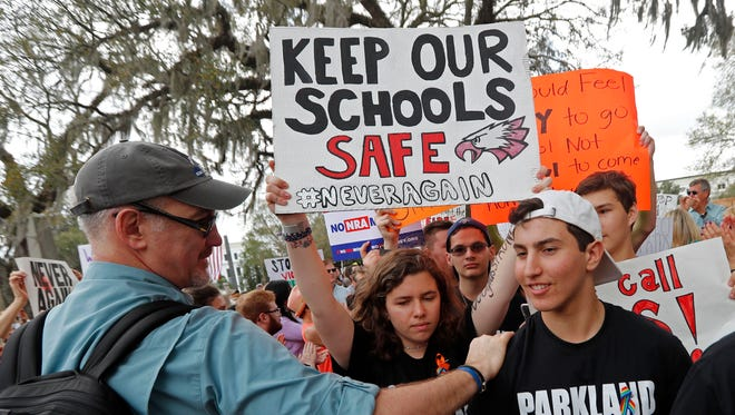 In this Wednesday, Feb. 21, 2018 file photo, student survivors from Marjory Stoneman Douglas High School are greeted as they arrive at a rally for gun control reform on the steps of the state capitol, in Tallahassee, Fla.