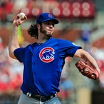 Dan Haren pitches during the sixth inning at Busch