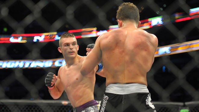 Johnny Case (red) and Frankie Perez (blue) compete during a lightweight bout at UFC Fight Night at TD Garden.