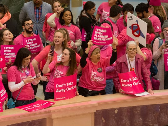 Advocates for Planned Parenthood rally after Gov. Scott Walker's budget address Wednesday.