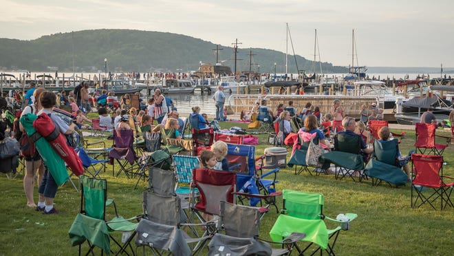 Local residents and visitors enjoy Munising's Bayshore Park on a hot July afternoon.