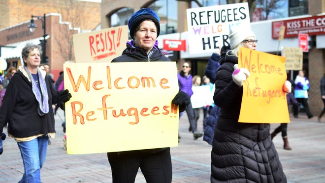 Participants in a rally in support of immigrants and refugees march down Church Street in Burlington on Sunday, Jan. 29, 2017.