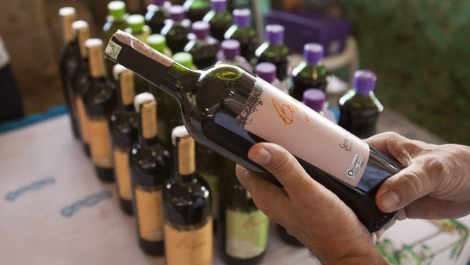 A man inspects a bottle of organic wine during a festival in Sao Paulo, Brazil on  Oct. 18.