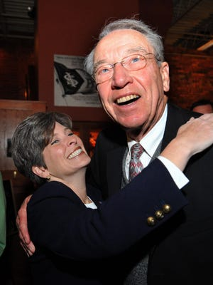 Republican Joni Ernst and U.S. Sen. Chuck Grassley greet supporters in this file photo from October 2014 in Ames, Iowa.