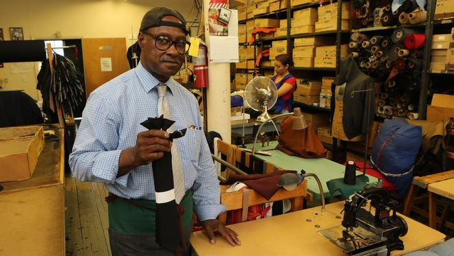 Albert Valentine, Jr. the owner of Valenti Neckwear Company in Yonkers, holds some of the clip-on ties he manufactures for law enforcement, at his shop in the SoYo Arts Building in Yonkers, July 28, 2016.