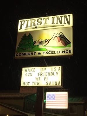 This sign at the First Inn of Pagosa Springs, Colo., subtly alerts customers that they're welcome to consume marijuana on the premises.