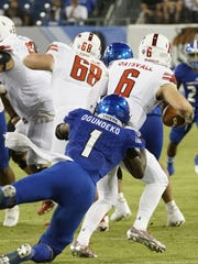 Tennessee State defensive end Ebo Ogundeko tackles Austin Peay quarterback Jeremiah Oatsvall in Saturday's game at Nissan Stadium.