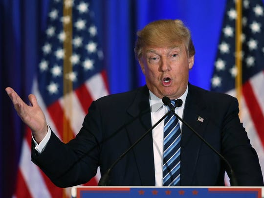 Donald Trump speaks at a press conference at the Trump
