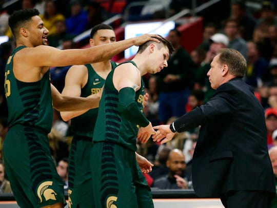 Michigan State guard Matt McQuaid (20) celebrates with