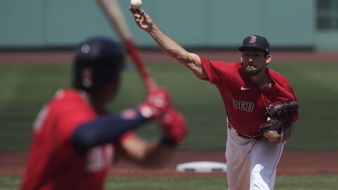 Red Sox starting pitcher Nathan Eovaldi delivers to the plate during the team's first intrasquad game Thursday at Fenway Park.