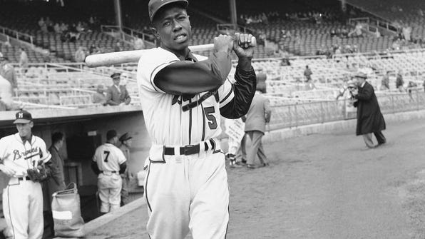 Hank Aaron in 1954 as a rookie outfielder for the Milwaukee Braves.