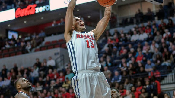 Mississippi forward Anthony Perez (13) dunks against Auburn forward Cinmeon Bowers (5) during the first half of an NCAA college basketball game at the Pavilion at Ole Miss on Wednesday, Jan. 27, 2016.