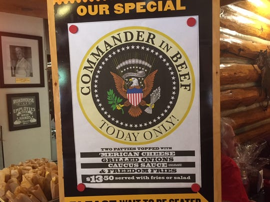 """The menu for the """"Commander In Beef"""" burger (with Freedom Fries) at the Roadhouse Diner on 15th Street North."""