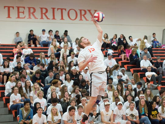 York Suburban's Zach Weinstein leaps up to serve the