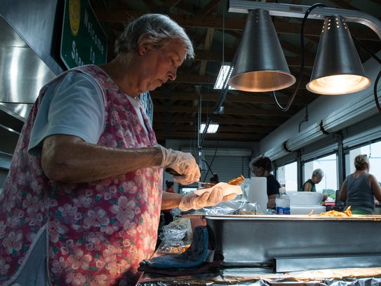 Lou Forster serves up soft crabs during the Sharptown