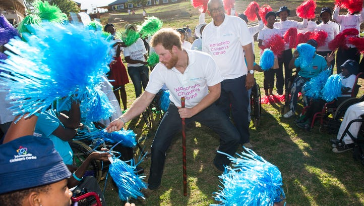 Prince Harry dances with children as Prince Seeiso