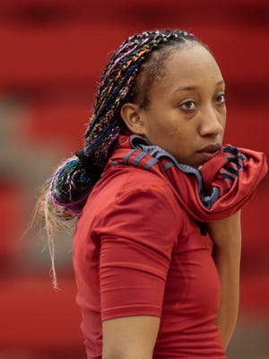 UL's Troi Swain watches the action during a break in practice earlier this month at E.K. Long Gym.