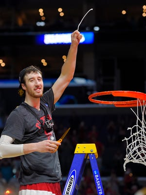 Wisconsin forward Frank Kaminsky cuts down the net after Wisconsin beat Arizona 85-78 in a college basketball regional final in the NCAA Tournament, Saturday, March 28, 2015, in Los Angeles.