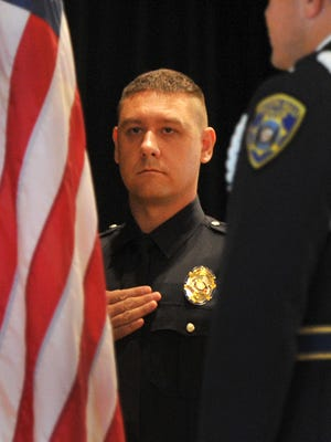 In this file photo, Wichita Falls Police Academy graduate Joseph Hobert honors the American flag during Posting of Colors at a ceremony celebrating the department's 70th police academy graduating class.
