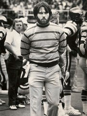 Kevin Reilly walking the Eagle's sideline after being deactivated for a knee injury in 1975.