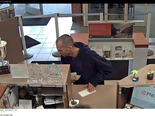 This surveillance video image was captured during a robbery at the PNC Bank branch at W. Saginaw St. and Waverly Rd. on Thursday, Aug. 17, 2017.
