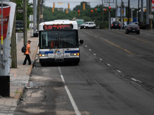 Commuters use the MTA bus system along Nolensville Road Wednesday, May 24, 2017, in Nashville, Tenn.