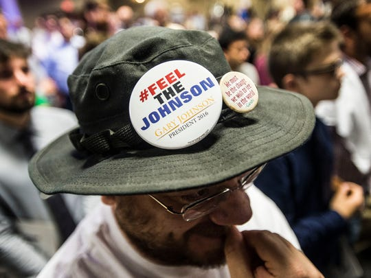 Archie Flower, 45, of Middleburg listens to Libertarian candidate for president Gary Johnson at the Sheraton Hotel in South Burlington Wednesday night.