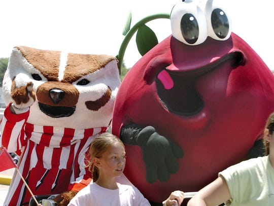 The Cranberry Guy hangs out with Bucky Badger at a