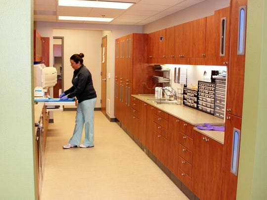 A LCHC staff member sterilizes equipment in a new open-concept
