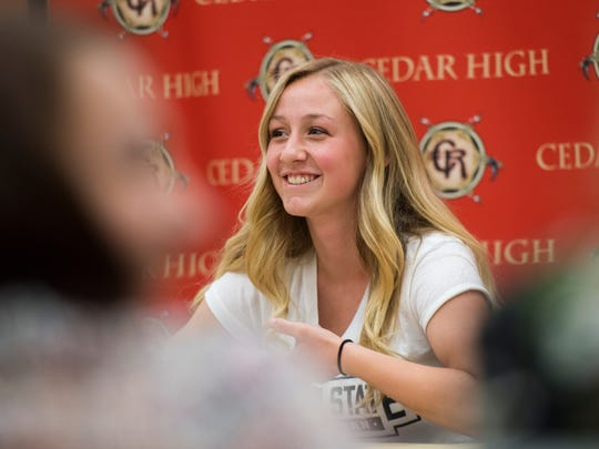 Cedar High School senior Tasha Kamachi signs a letter of intent to play soccer for Utah State Eastern at a ceremony in CHS Wednesday, May 9, 2018.