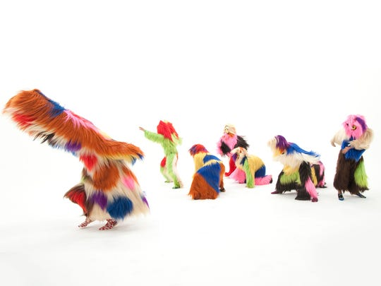 """Artist Nick Cave directs """"soundsuit invasions,"""" where choreographed dancers wear costumes like these and perform with musicians in city streets and at universities and high schools."""