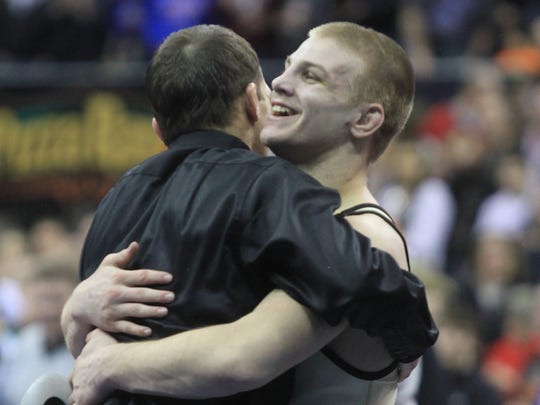 2013: Jake Marlin of Creston-OM celebrates after defeating
