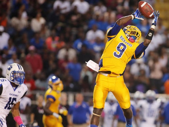 Rickards receiver Kalen Riles makes a spectacular catch against Godby in 2013.