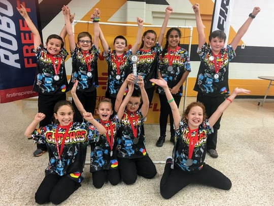 Team Glitches show off their first place Core Values award Saturday, Jan. 13 at Alamogordo High School.