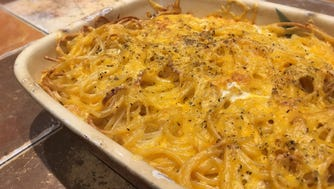 Baked spaghetti and cheese.