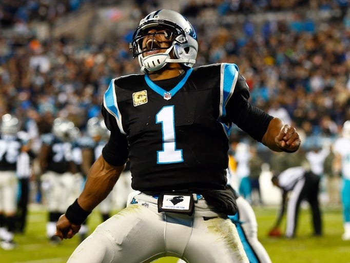 Panthers quarterback Cam Newton celebrates a touchdown