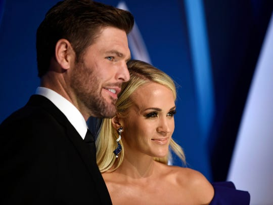 Carrie Underwood and husband Mike Fisher on Nov. 8,